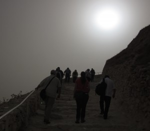 The sun blazed through haze as we climbed to the top of Herodion.