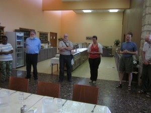 The Tantur participants gather in the dining room for grace before the meal.