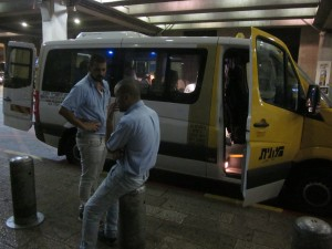 The Nesher Shuttle drivers discussed which one would go to Tantur.