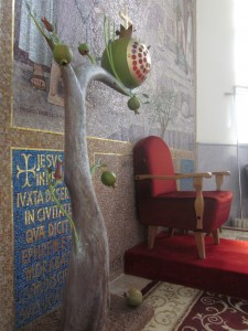 the Latin Church of Christ the Savior has a sanctuary lamp in the form of a pomegranate tree.