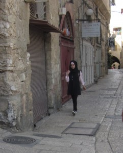 A girl hurries through the Jewish Quarter.