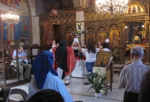 The celebrant reverenced the flowered cross.