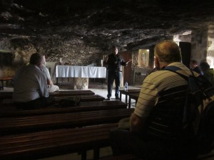 Guide Elias Ghareeb explains how shepherds would often shelter their flocks in a cave.