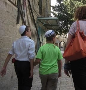 Boys hurry home for Rosh HaShanah.