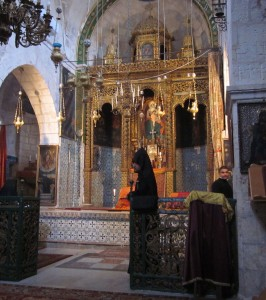 A funeral was in process at Deir el-Zeitouneh.