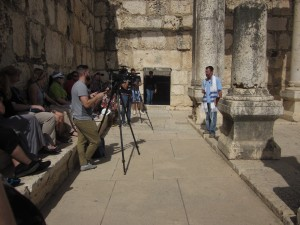 A Christian evangelist preaches to the camera.