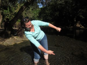 Janelle Neubauer skips a stone at the Jordan's source.