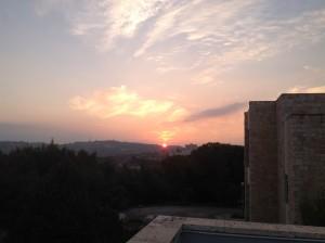 The sun sets behind Tantur.